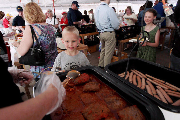 Record-Eagle/Keith King<br /> Brennan Burgess, 6, of Traverse City, and his sister Cassidy Burgess, right, 10, get their food Sunday, May 20, 2012 during the 57th annual Northwestern Michigan College Barbecue.