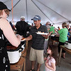 Record-Eagle/Keith King<br /> Jose Tapia, of Traverse City, and his daughter Sadie Tapia, 3, get their food Sunday, May 20, 2012 during the 57th annual Northwestern Michigan College Barbecue.