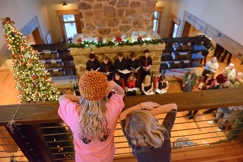 Justin Sheely | The Sheridan Press<br /> Children look down from the loft during the 5th annual Ucross Christmas Celebration at the Raymond Plank Creative Center at Ucross Saturday, Dec. 9, 2017.