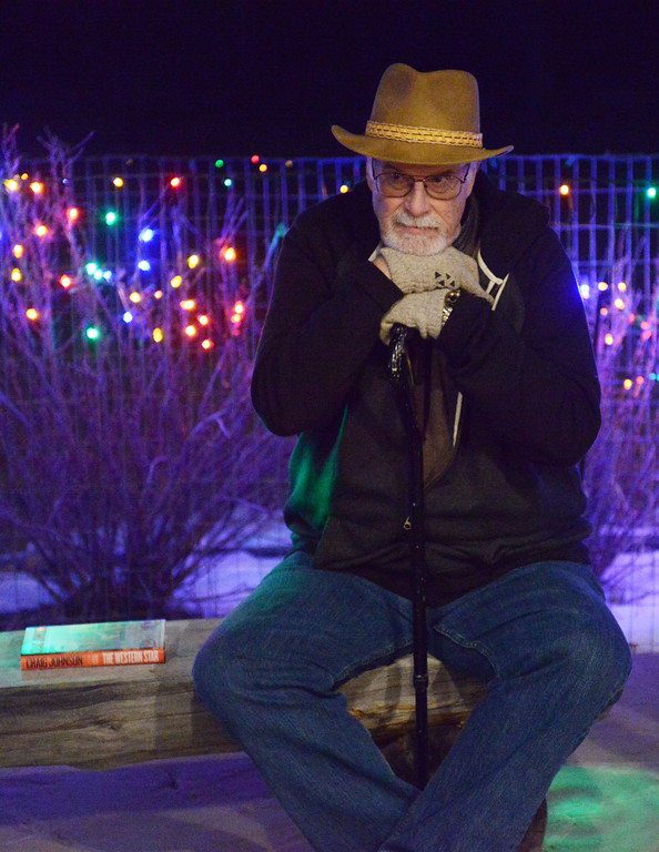 Justin Sheely | The Sheridan Press<br /> Bill Charles sits on a bench during the 5th annual Ucross Christmas Celebration at the Raymond Plank Creative Center at Ucross Saturday, Dec. 9, 2017.