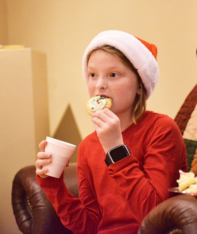 Justin Sheely | The Sheridan Press<br /> Nine-year-old Shelbty Ganje of Gillette, Wyoming, bites into a cookie during the 5th annual Ucross Christmas Celebration at the Raymond Plank Creative Center at Ucross Saturday, Dec. 9, 2017.