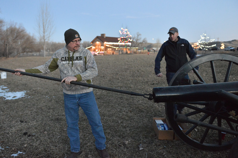 Justin Sheely | The Sheridan Press<br /> Joe Reed loads a charge into the cannon as Chris Debban looks on during the 5th annual Ucross Christmas Celebration at the Raymond Plank Creative Center at Ucross Saturday, Dec. 9, 2017.