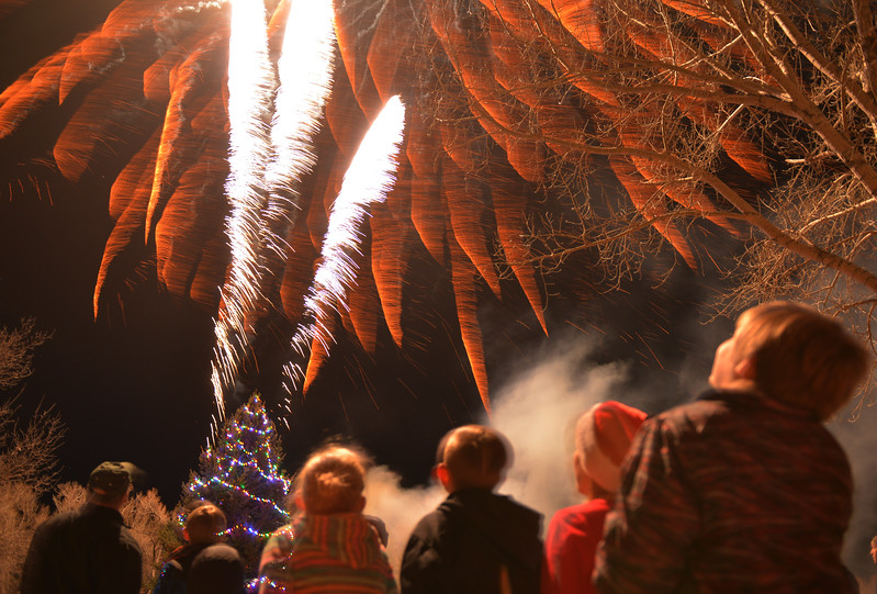Justin Sheely | The Sheridan Press<br /> Children look on as fireworks by Bruce Burns light up the sky during the 5th annual Ucross Christmas Celebration at the Raymond Plank Creative Center at Ucross Saturday, Dec. 9, 2017.