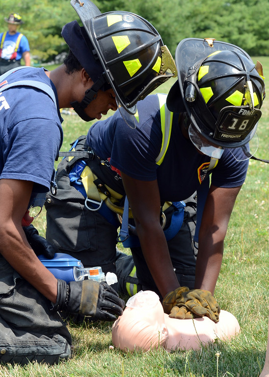 . Fire Department of Motgomery Township Company perform CPR as they take part in the 14th annual Montgomery County Fifth Fire District Water Battle held at the Towamencin Firehouse on Saturday morning July 12,2014.Photo by Mark C Psoras/The Reporter