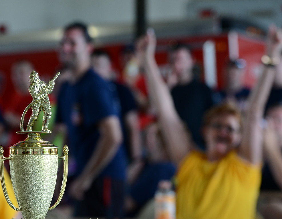 . Trophies are awarded during the conclusion of the 14th annual Montgomery County Fifth Fire District Water Battle held at the Towamencin Firehouse on Saturday morning July 12,2014.Photo by Mark C Psoras/The Reporter