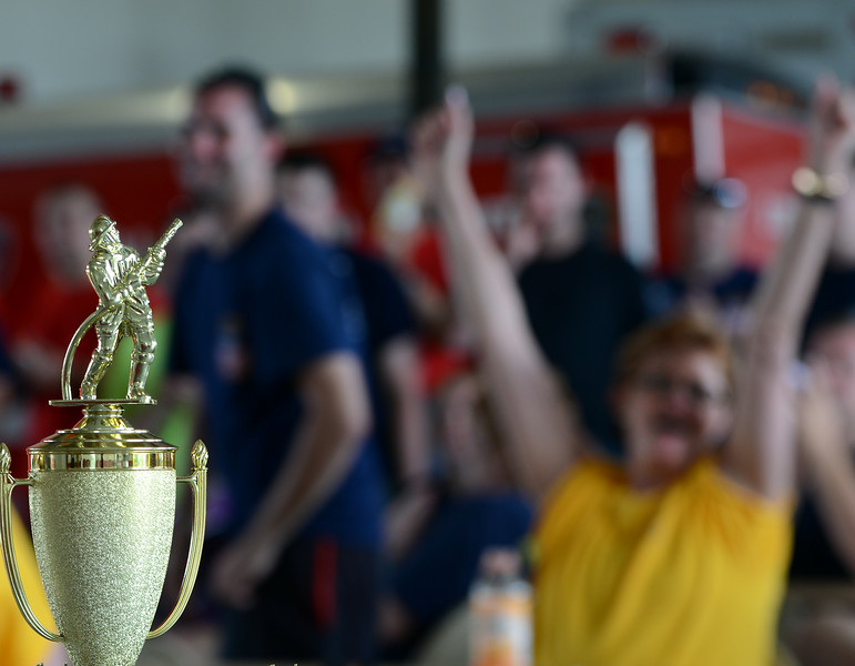Trophies are awarded during the conclusion of the 14th annual Montgomery County Fifth Fire District Water Battle held at the Towamencin Firehouse on Saturday morning July 12,2014.Photo by Mark C Psoras/The Reporter
