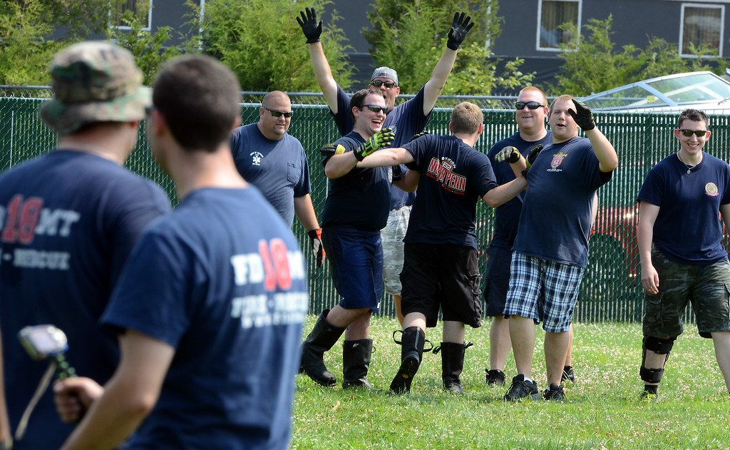 . North Penn  Fire Company members celebrate after defeating FDMT in a tug-of-war competition during the 14th annual Montgomery County Fifth Fire District Water Battle held at the Towamencin Firehouse on Saturday morning July 12,2014.Photo by Mark C Psoras/The Reporter