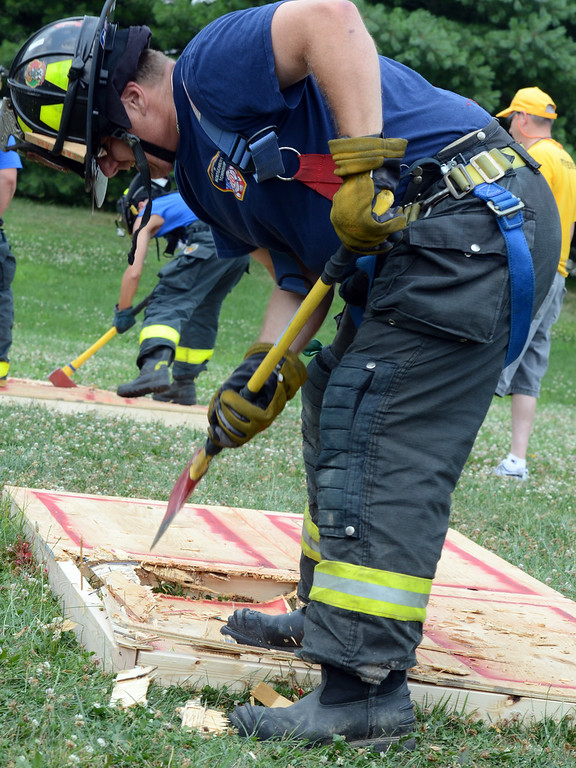 . Fire Department of Motgomery Township Company members compete against Colmar as they take part in the 14th annual Montgomery County Fifth Fire District Water Battle held at the Towamencin Firehouse on Saturday morning July 12,2014.Photo by Mark C Psoras/The Reporter