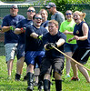North Penn  Fire Company members take part in a tug-of-war competition during the 14th annual Montgomery County Fifth Fire District Water Battle held at the Towamencin Firehouse on Saturday morning July 12,2014.Photo by Mark C Psoras/The Reporter
