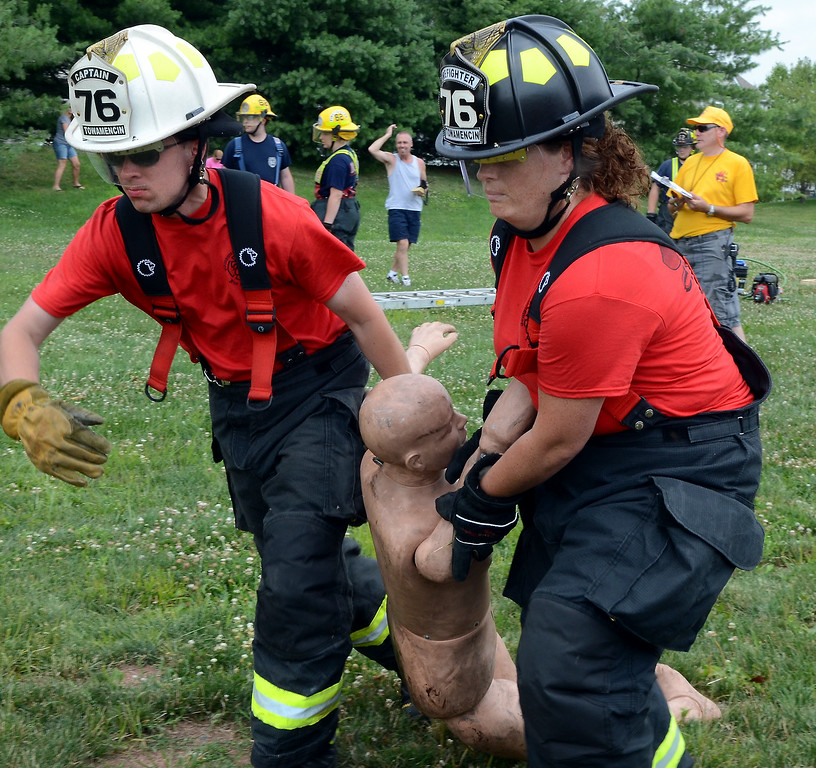 . Towamencin Fire Company members drag a dummy as they compete in the 14th annual Montgomery County Fifth Fire District Water Battle held at the Towamencin Firehouse on Saturday morning July 12,2014.Photo by Mark C Psoras/The Reporter