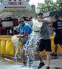 Hatfield  Fire Company members take part in a bucket brigade competition during the 14th annual Montgomery County Fifth Fire District Water Battle held at the Towamencin Firehouse on Saturday morning July 12,2014.Photo by Mark C Psoras/The Reporter