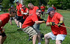 Towamencin Fire Company members take part in a tug-of-war competition during the 14th annual Montgomery County Fifth Fire District Water Battle held at the Towamencin Firehouse on Saturday morning July 12,2014.Photo by Mark C Psoras/The Reporter