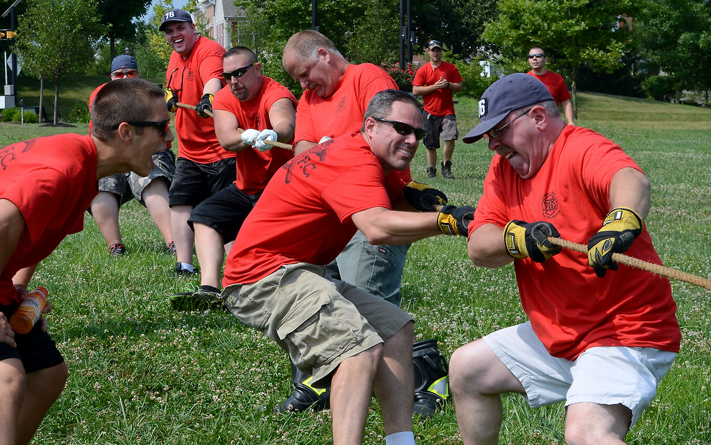 . Towamencin Fire Company members take part in a tug-of-war competition during the 14th annual Montgomery County Fifth Fire District Water Battle held at the Towamencin Firehouse on Saturday morning July 12,2014.Photo by Mark C Psoras/The Reporter