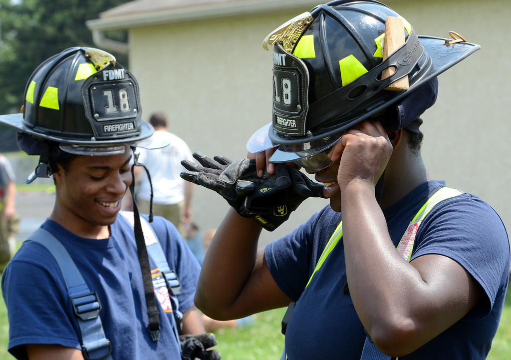 . Fire Department of Motgomery Township Company members gear up as they take part in the 14th annual Montgomery County Fifth Fire District Water Battle held at the Towamencin Firehouse on Saturday morning July 12,2014.Photo by Mark C Psoras/The Reporter