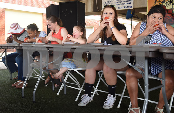 People compete in a tomato peeling contest at the Jacksonville Tomato Fest Saturday June 11, 2016 in Jacksonville, Texas. In its 32nd year, the week-long festival included tomato themed events such as a salsa contest,  best homegrown tomato contest and eating contest as well as other activities such as a murder mystery dinner, ski show and dodgeball tournament.  (Sarah A. Miller/Tyler Morning Telegraph)