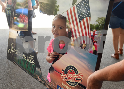 Sadie Harvey, 3, of Whitehouse, has her photo taken in a Jacksonville picture frame at the Jacksonville Tomato Fest Saturday June 11, 2016 in Jacksonville, Texas. In its 32nd year, the week-long festival included tomato themed events such as a salsa contest,  best homegrown tomato contest and eating contest as well as other activities such as a murder mystery dinner, ski show and dodgeball tournament.  (Sarah A. Miller/Tyler Morning Telegraph)