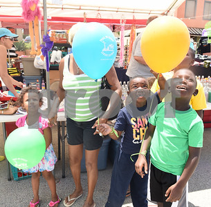Starr Benton, 5, Lamarya Benton, 6, and Lamarion Benton, 8, carry balloons as they attend the Jacksonville Tomato Fest with their grandmother Lois Sturges Saturday June 11, 2016 in Jacksonville, Texas. In its 32nd year, the week-long festival included tomato themed events such as a salsa contest,  best homegrown tomato contest and eating contest as well as other activities such as a murder mystery dinner, ski show and dodgeball tournament.  (Sarah A. Miller/Tyler Morning Telegraph)