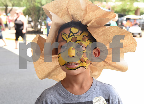Alex Sarmiento, 5, of Phoenix, Arizona wears a paper hat and giraffe facepaint at the Jacksonville Tomato Fest Saturday June 11, 2016 in Jacksonville, Texas. In its 32nd year, the week-long festival included tomato themed events such as a salsa contest,  best homegrown tomato contest and eating contest as well as other activities such as a murder mystery dinner, ski show and dodgeball tournament.  (Sarah A. Miller/Tyler Morning Telegraph)