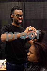 Chris Noble blows out LaQueta Timmons' hair during the East Texas Hair and Beauty Expo Hair at Harvey Hall Convention Center in Tyler, Texas, on Monday, June 12, 2017. The expo featured vendors and products from across the South. (Chelsea Purgahn/Tyler Morning Telegraph)