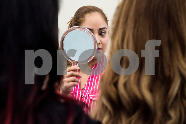 Sandy Arroyo checks her face in a mirror after getting her makeup done during the East Texas Hair and Beauty Expo Hair at Harvey Hall Convention Center in Tyler, Texas, on Monday, June 12, 2017. The expo featured vendors and products from across the South. (Chelsea Purgahn/Tyler Morning Telegraph)