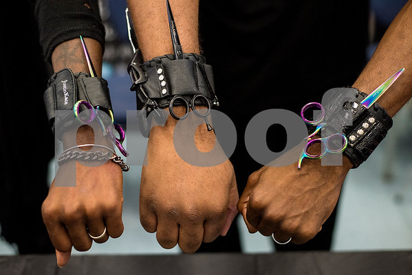 Cortez Durr, Justin Kace and Rondra Durr pose for a photo during the East Texas Hair and Beauty Expo Hair at Harvey Hall Convention Center in Tyler, Texas, on Monday, June 12, 2017. The expo featured vendors and products from across the South. (Chelsea Purgahn/Tyler Morning Telegraph)