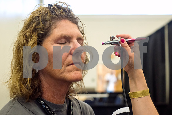 Cynthia Edmonson closes her eyes as Brooke Kirk does Edmonson's makeup during the East Texas Hair and Beauty Expo Hair at Harvey Hall Convention Center in Tyler, Texas, on Monday, June 12, 2017. The expo featured vendors and products from across the South. (Chelsea Purgahn/Tyler Morning Telegraph)