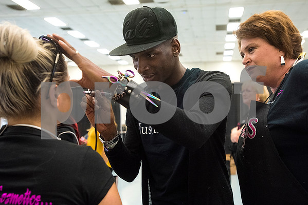 Cortez Durr, center, does Perla Barzinjee's, left, makeup as Christa Ashlock, right, watches during the East Texas Hair and Beauty Expo Hair at Harvey Hall Convention Center in Tyler, Texas, on Monday, June 12, 2017. The expo featured vendors and products from across the South. (Chelsea Purgahn/Tyler Morning Telegraph)