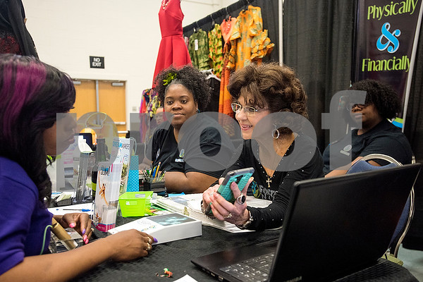 Ayesha Tennyson, left, and Minnie Rush, center, listens as Sandra Barnes, right, speaks during the East Texas Hair and Beauty Expo Hair at Harvey Hall Convention Center in Tyler, Texas, on Monday, June 12, 2017. The expo featured vendors and products from across the South. (Chelsea Purgahn/Tyler Morning Telegraph)