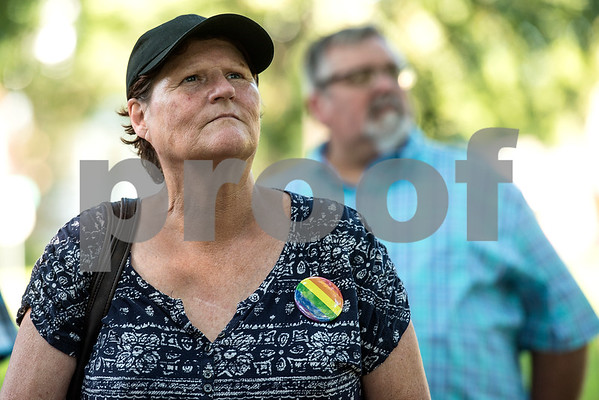 Victoria Brewer listens during a memorial honoring victims of the Orlando Pulse nightclub shooting in Tyler, Texas, on Monday, June 12, 2017. Monday marked the one year anniversary of the deadliest mass shooting in modern U.S. history. (Chelsea Purgahn/Tyler Morning Telegraph)