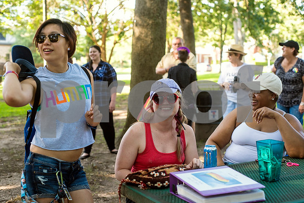 Jill Hsu, Rachel Joseph and Maya Johnigan hang out before a memorial honoring victims of the Orlando Pulse nightclub shooting in Tyler, Texas, on Monday, June 12, 2017. Monday marked the one year anniversary of the deadliest mass shooting in modern U.S. history. (Chelsea Purgahn/Tyler Morning Telegraph)