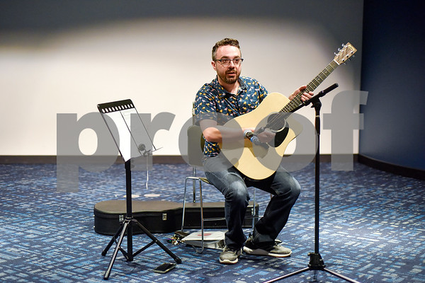 Brandon McManus leads free guitar lessons at the Tyler Public Library in Tyler, Texas, on Thursday, June 14, 2018. The library partnered with Guitar Center for their 2018 Summer Reading Program to host five beginner guitar lessons throughout the summer. (Chelsea Purgahn/Tyler Morning Telegraph)