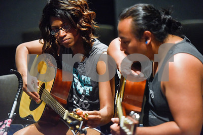Stephanie and Josh Garcia tune their guitars during free guitar lessons at the Tyler Public Library in Tyler, Texas, on Thursday, June 14, 2018. The library partnered with Guitar Center for their 2018 Summer Reading Program to host five beginner guitar lessons throughout the summer. (Chelsea Purgahn/Tyler Morning Telegraph)