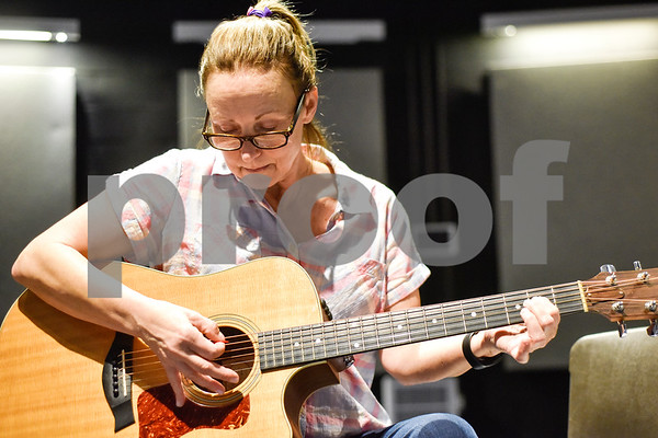 Julie Lauer practices a new song during free guitar lessons at the Tyler Public Library in Tyler, Texas, on Thursday, June 14, 2018. The library partnered with Guitar Center for their 2018 Summer Reading Program to host five beginner guitar lessons throughout the summer. (Chelsea Purgahn/Tyler Morning Telegraph)