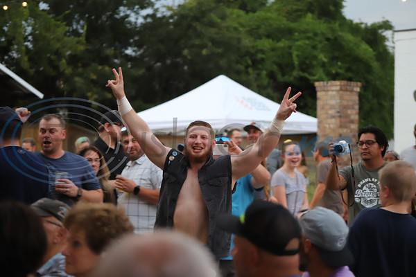 Wrestler Nate Jolly makes his way through the crowd at True Vine Brewing Company. Sarah Perez/Freelance
