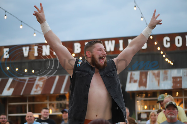 Wrestler Nate Jolly pumps up the crowd at True Vine Brewing Company during Brawl at the Brewery an event to Benefit the East Texas Food Bank. Sarah Perez/Freelance