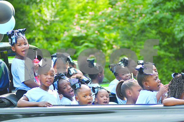 Girls of the Cheer Knowledge cheerleading gym ready for the start of the parade by singing and chanting. (Victor Texcucano)