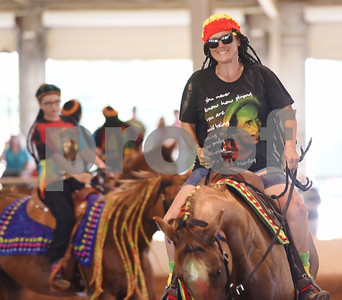 The Ghostrider's Cowgirls Extreme adult mixed quad team performs to music by Bob Marley during Super Ride XIV 2016 International Festival Of The Equestrian Arts held at Texas Rose Horse Park in Lindale June 15, 2016. The event continues through Saturday and features equestrian drill team and trick riding competitions. Pictured is Stephanie Schall of Grand Saline.  (Sarah A. Miller/Tyler Morning Telegraph)