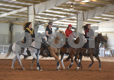 The Ghostrider's Cowgirls Inc. adult quad team members Kelsie Spencer of Mabank, Sara Bass of Phalba, Cristal Dawson of Campbell and Brooke Berry of Malakoff ride to several Beyonce songs during Super Ride XIV 2016 International Festival Of The Equestrian Arts held at Texas Rose Horse Park in Lindale June 15, 2016. The event continues through Saturday and features equestrian drill team and trick riding competitions.   (Sarah A. Miller/Tyler Morning Telegraph)