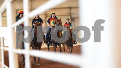 The Ghostrider's Cowgirls Extreme adult mixed quad team performs to music by Bob Marley during Super Ride XIV 2016 International Festival Of The Equestrian Arts held at Texas Rose Horse Park in Lindale June 15, 2016. The event continues through Saturday and features equestrian drill team and trick riding competitions. Pictured from left: Stephanie Schall of Grand Saline, Journey Coey, 10, of Mineola, Holly Coey of Mineola and Kaylie Robert, 12, of Mineola.  (Sarah A. Miller/Tyler Morning Telegraph)