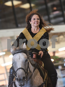 The Ghostrider's Cowgirls Inc. adult quad team member Kelsie Spencer of Mabank wears an outfit from Beyonce's Super Bowl performances as the quad team rides to several Beyonce songs during Super Ride XIV 2016 International Festival Of The Equestrian Arts held at Texas Rose Horse Park in Lindale June 15, 2016. The event continues through Saturday and features equestrian drill team and trick riding competitions.   (Sarah A. Miller/Tyler Morning Telegraph)