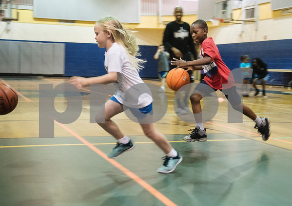 Sadie Woods, 7, and Jacoryian Pitts, 8, race each other at the Rose City Warriors summer basketball camp at the Glass Recreation Center Monday June 19, 2017.  (Sarah A. Miller/Tyler Morning Telegraph)