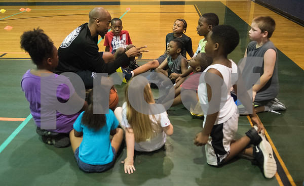 Coach Romen Tucker puts instructs children at his Rose City Warriors summer basketball camp at the Glass Recreation Center Monday June 19, 2017.  (Sarah A. Miller/Tyler Morning Telegraph)