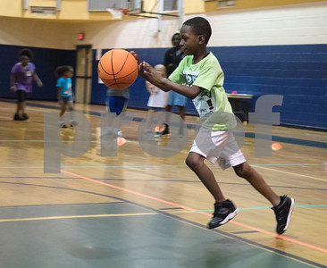 Isaiah Wilson, 8, dribbles at the Rose City Warriors summer basketball camp at the Glass Recreation Center Monday June 19, 2017.  (Sarah A. Miller/Tyler Morning Telegraph)