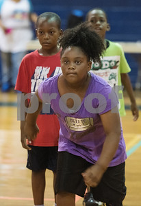 Charislyn Mass, 8, participates in the Rose City Warriors summer basketball camp at the Glass Recreation Center Monday June 19, 2017.  (Sarah A. Miller/Tyler Morning Telegraph)