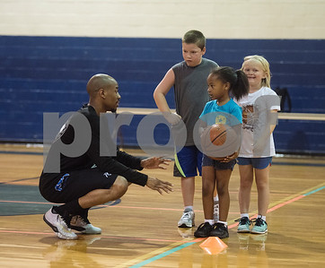 Coach Romen Tucker puts instructs Reign McClendon, 5, at his Rose City Warriors summer basketball camp at the Glass Recreation Center Monday June 19, 2017.  (Sarah A. Miller/Tyler Morning Telegraph)