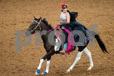 A girl competes during the quadrille competition at Super Ride XV at Henderson County Regional Fair Park Complex in Athens, Texas, on Wednesday, June 21, 2017. The event features a variety of equestrian competitions such as trick riding and vaulting. (Chelsea Purgahn/Tyler Morning Telegraph)
