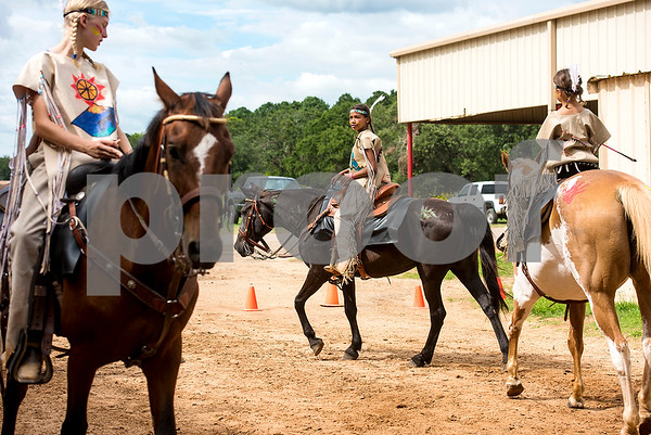 Allie Fanoval, 12, center, preps for competition with her team during the quadrille competition at Super Ride XV at Henderson County Regional Fair Park Complex in Athens, Texas, on Wednesday, June 21, 2017. The event features a variety of equestrian competitions such as trick riding and vaulting. (Chelsea Purgahn/Tyler Morning Telegraph)