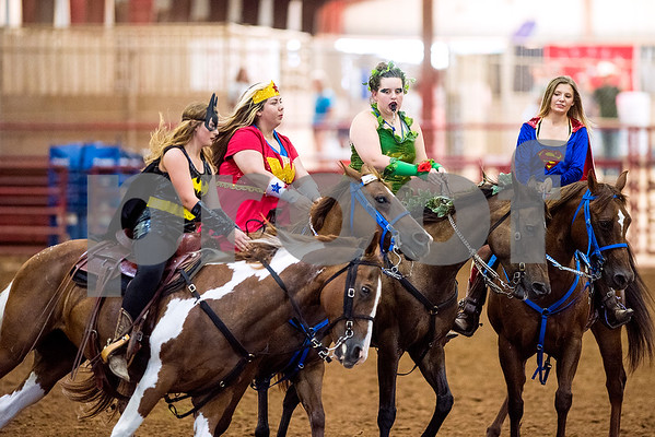 From left, Julianne Babina, Brook Berry, Tory Whitus and Payton Henisey compete People compete during the quadrille competition at Super Ride XV at Henderson County Regional Fair Park Complex in Athens, Texas, on Wednesday, June 21, 2017. The event features a variety of equestrian competitions such as trick riding and vaulting. (Chelsea Purgahn/Tyler Morning Telegraph)
