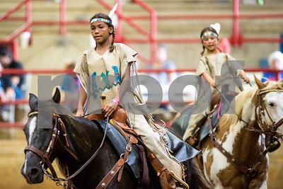 Allie Fanoval, 12, and Ava Urbanovsky, 9, compete during the quadrille competition at Super Ride XV at Henderson County Regional Fair Park Complex in Athens, Texas, on Wednesday, June 21, 2017. The event features a variety of equestrian competitions such as trick riding and vaulting. (Chelsea Purgahn/Tyler Morning Telegraph)