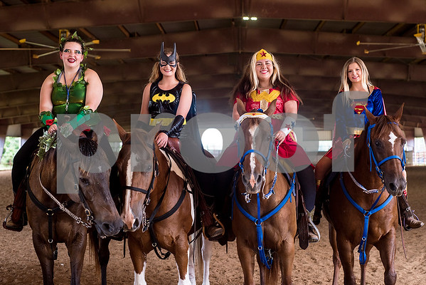Tory Whitus, Julianne Babina, Brooke Berry and Payton Henisey pose for a photo during the quadrille competition at Super Ride XV at Henderson County Regional Fair Park Complex in Athens, Texas, on Wednesday, June 21, 2017. The event features a variety of equestrian competitions such as trick riding and vaulting. (Chelsea Purgahn/Tyler Morning Telegraph)